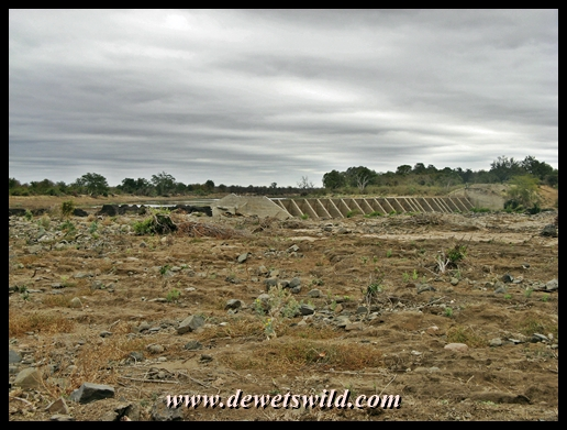 What's left of the Kanniedood Dam wall. Not a single tree remain standing in the immediate area below the broken wall!