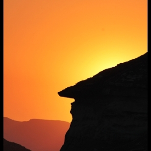The sun setting behind the mushroom rocks