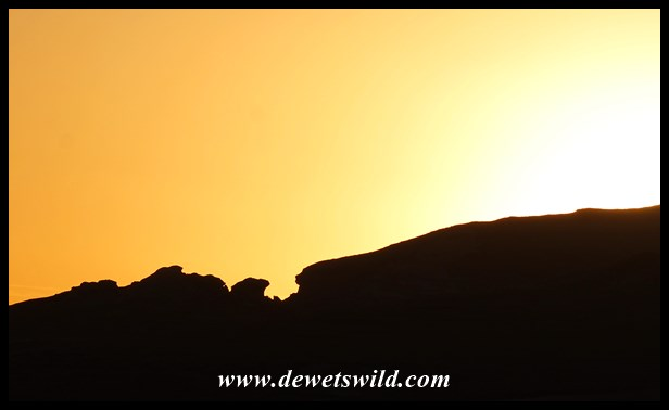 Craggy heights silhouetted at sunrise