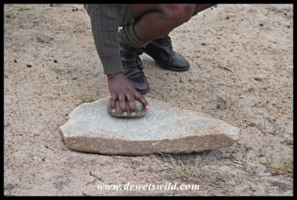 Ronnie demonstrating another grinding stone we came across