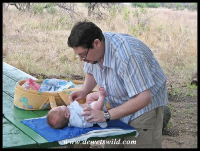 2 Months old: October 2009. First visit to the Kruger National Park, and time for a nappy change in the bush!