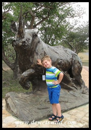 5 Years old: December 2014. Posing at the Ezemvelo KZN Wildlife logo at Hluhluwe-Imfolozi Park's Centenary Centre