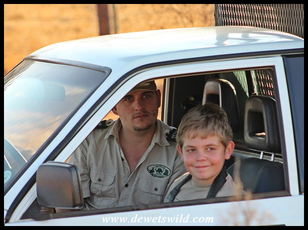 10 years old: August 2019. Joubert sitting next to the ranger-guide on a tour to see Rietvlei's lions