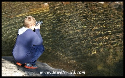 9 years old: June 2019. Joubert photographing reflections at Giant's Castle