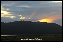 Sunrise over Lake Bhangazi and the forested dunes of Cape Vidal