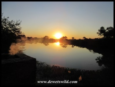 Sunset at Tlopi, with the smoke from our braai fire wafting over the dam